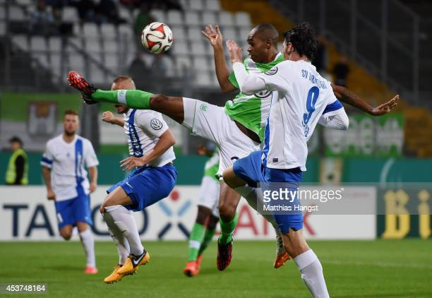 Naldo of Wolfsburg saves the ball against Dominik StrohEngel of Darmstadt during the DFB Cup first round match between SV Darmstadt 98 and VfL...