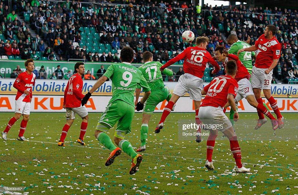 Naldo (2.R) of Wolfsburg scores his team's first goal with a header during the Bundesliga match between VFL Wolfsburg and FC Augsburg at Volkswagen Arena on February 2, 2013 in Wolfsburg, Germany.