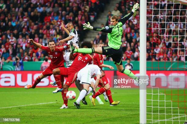Naldo of Wolfsburg tries to score against Daniel van Buyten Dante Bastian Schweinsteiger and goalkeeper Manuel Neuer of Muenchen during the DFB Cup...