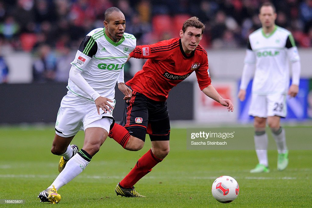 Naldo of Wolfsburg (L) vies with Stefan Reinartz of Leverkusen (R) during the Bundesliga match between Bayer 04 Leverkusen and VfL Wolfsburg at BayArena on April 6, 2013 in Leverkusen, Germany.