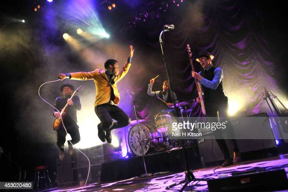 Nalle Colt Ty Taylor Richard Danielson and Rick Barrio Dill of Vintage Trouble performs on stage at Islington Assembly Hall on July 30 2014 in London...