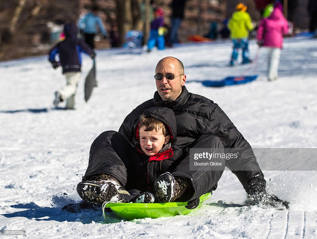 Nalu Appleton, 4, rode a sled with his dad, Thomas Appleton, down a small hill on Boston Common after a blizzard dropped over two feet of snow in the area, Sunday, Feb. 10, 2013.