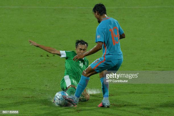 Nam Ngai Tong of Macau and Holi Charan Nazary of India chase the ball during the 2019 AFCAsian Cup qualifying match between India and Macau held at...