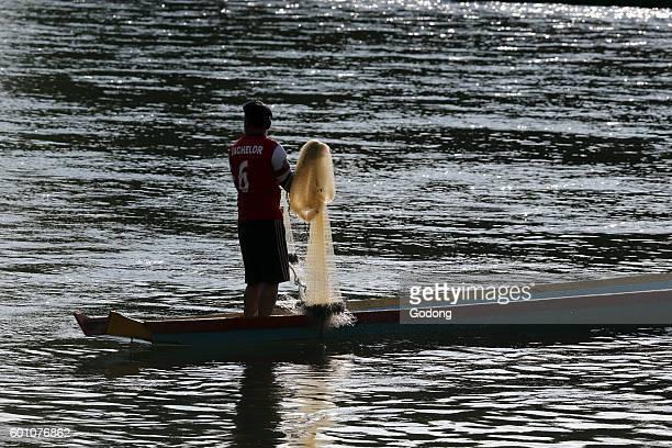 Nam Song river Long tail boat Fisherman Vang Vieng Laos