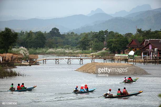Nam Song river Long tail boat Sunset cruise Vang Vieng Laos