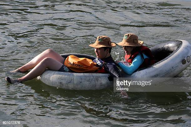activity of floating down on a large rubber tyre Vang Vieng Laos