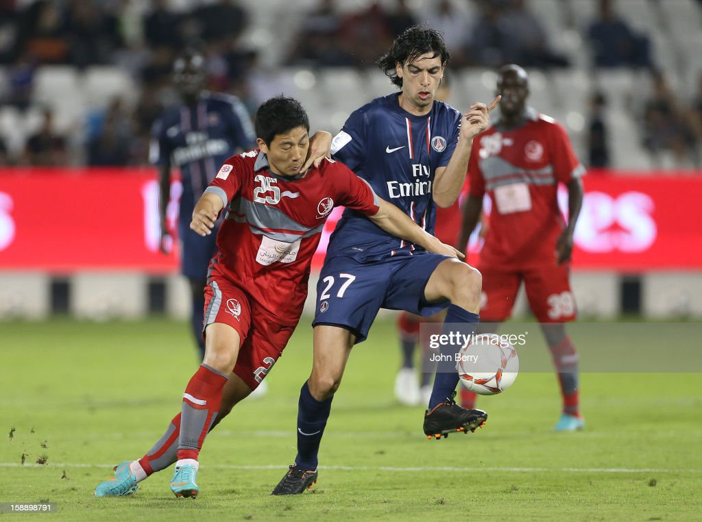 Nam Taehee of Lekhwiya SC and <a gi-track='captionPersonalityLinkClicked' href=/galleries/search?phrase=Javier+Pastore&family=editorial&specificpeople=5857872 ng-click='$event.stopPropagation()'>Javier Pastore</a> of PSG in action during the friendly match between Paris Saint-Germain FC and Lekhwiya Sports Club at the Al-Sadd Sports Club stadium on January 2, 2013 in Doha, Qatar.