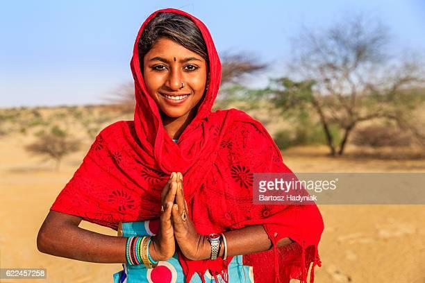 Namaste! Portrait of happy Indian girl in desert village, India
