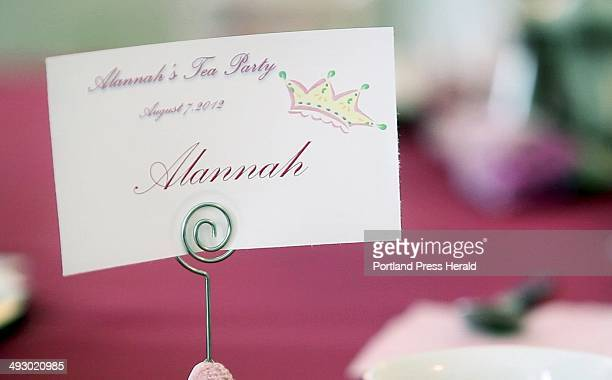 A name card for Alannah Shevenell sits on a table in the Longfellow Room at the Portland Regency Hotel where a tea party was held in her honor on...