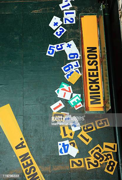 A name plate bearing the name of Phil Mickelson of the United States is seen by a leaderboard during the final round of The 140th Open Championship...