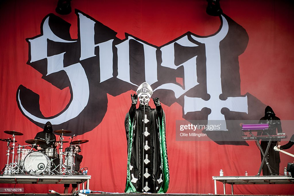 A nameless Ghoul, Papa Emeritus II (formerly known as Papa Emeritus) and a nameless Ghoul of Ghost perform onstage on Day 3 of The Download Festival at Donnington Park on June 16, 2013 in Donnington, England.