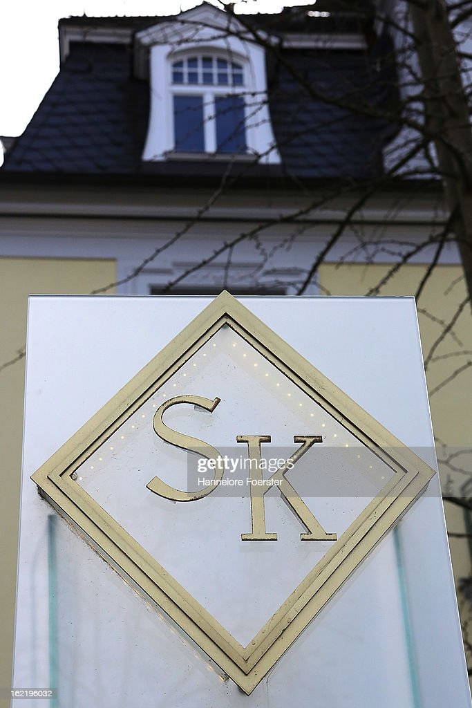 A nameplate at the headquarters of the S&K investment group is displayed outside the day after police raided the company's offices on February 20, 2013 in Frankfurt, Germany. Police made six arrests across Germany and state prosecutors are charging that the company has swindled investors out of investments totaling over one hundred million Euros. At least one of the company's founders, Jonas Koeller and Stephan Schaefer, was among those arrested yesterday.