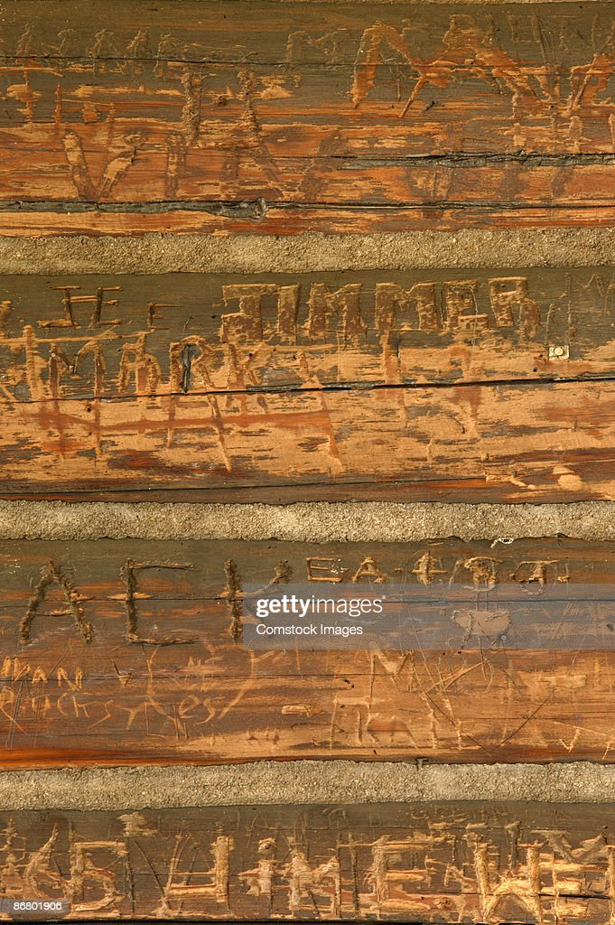 Names carved into wood stock photo getty images