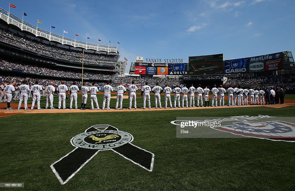 Names of the victims from the Newtown, Connecticut school shooting scroll accross the screen during a moment of silence before the game between the New York Yankees and the Boston Red Sox during Opening Day on April 1, 2013 at Yankee Stadium in the Bronx borough of New York City.