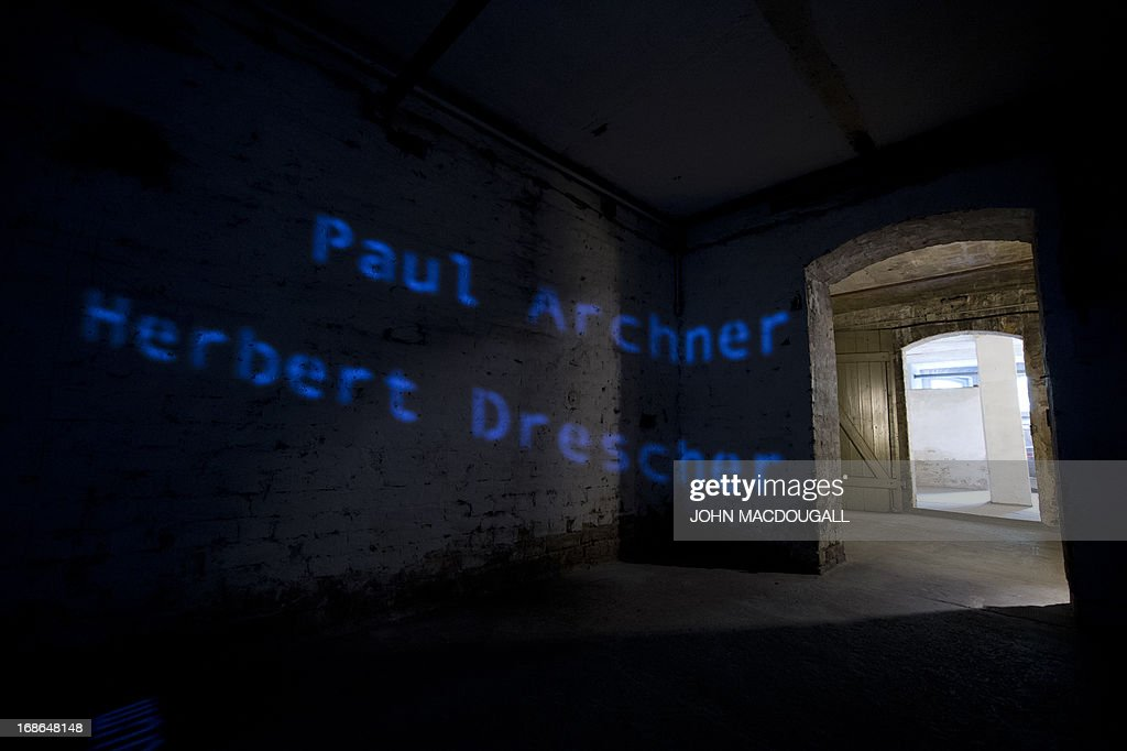 Names of victims who died in the prison are projected on the wall in one of the communal cells of the SA Prison Papestrasse, an early concentration camp (March to December 1933) run by the SA (Sturmabteilung) Field Police, taken May 8, 2013 in Berlin. Some 500 people, mostly Nazi regime opponents, were incarcerated (though unofficial estimations put the number to 2.000), beaten up and tortured in the SA Prison Papestrasse, located in the former barracks of the Prussian Railway Regiment). Inmates are known to have died in the prison, or as a result of their maltreatment there. The prison stands as an early example of what later became systematic and organised terror.
