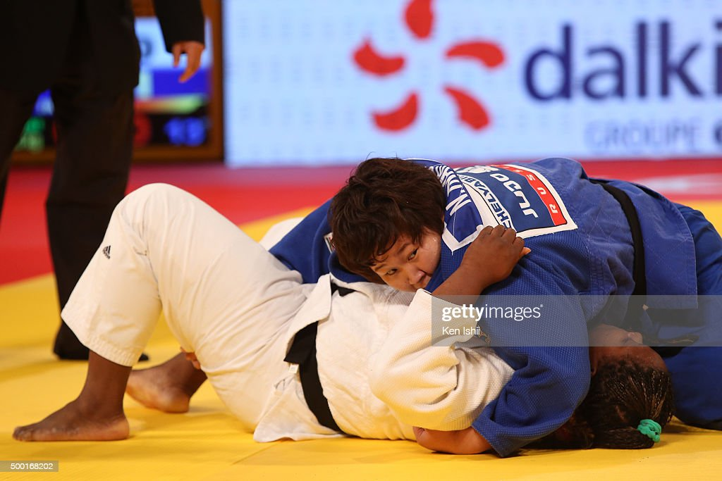 Nami Inamori of Japan (blue) holds <a gi-track='captionPersonalityLinkClicked' href=/galleries/search?phrase=Idalys+Ortiz&family=editorial&specificpeople=5492242 ng-click='$event.stopPropagation()'>Idalys Ortiz</a> of Cuba for ippon in the Women' +78kg final at Tokyo Metropolitan Gymnasium on December 6, 2015 in Tokyo, Japan.
