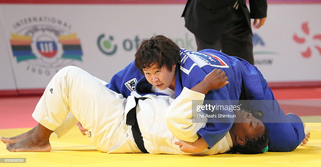 Nami Inamori of Japan (blue) holds <a gi-track='captionPersonalityLinkClicked' href=/galleries/search?phrase=Idalys+Ortiz&family=editorial&specificpeople=5492242 ng-click='$event.stopPropagation()'>Idalys Ortiz</a> (white) of Cuba for ippon in the Women' +78kg final during day three of the Judo Grand Slam at Tokyo Metropolitan Gymnasium on December 6, 2015 in Tokyo, Japan.