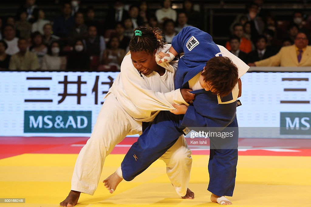Nami Inamori of Japan (blue) throws <a gi-track='captionPersonalityLinkClicked' href=/galleries/search?phrase=Idalys+Ortiz&family=editorial&specificpeople=5492242 ng-click='$event.stopPropagation()'>Idalys Ortiz</a> of Cuba in the Women' +78kg final at Tokyo Metropolitan Gymnasium on December 6, 2015 in Tokyo, Japan.
