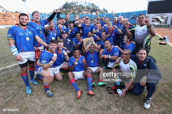 Namibia celebrate after qualifying for the RWC 2015 finals after thier victory during the Rugby World Cup 2015 qualifying match between Madagascar...