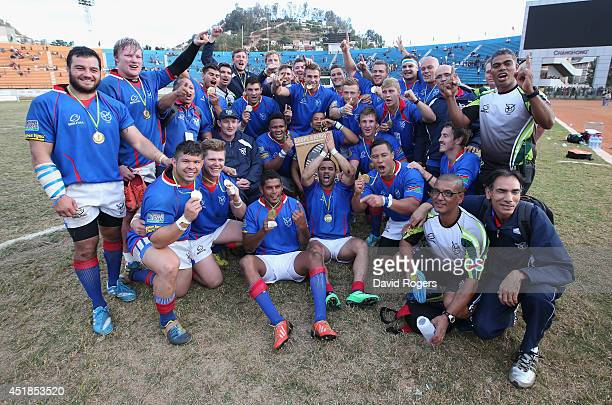 Namibia celebrate after qualifying for the RWC 2015 finals after their victory during the Rugby World Cup 2015 qualifying match between Madagascar...