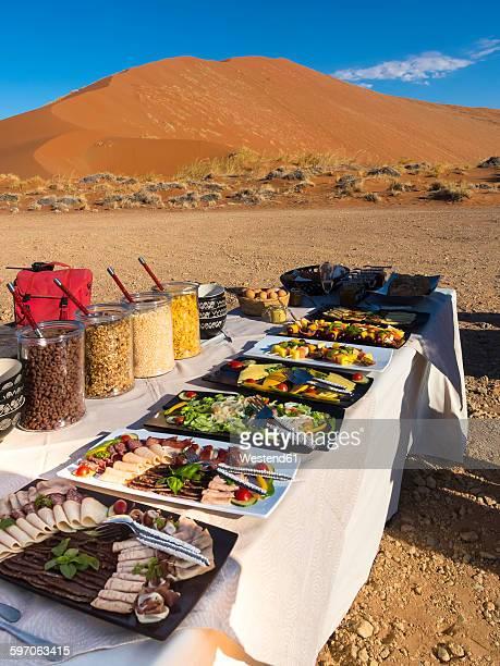 Namibia, Hardap, breakfast buffet on table in desert
