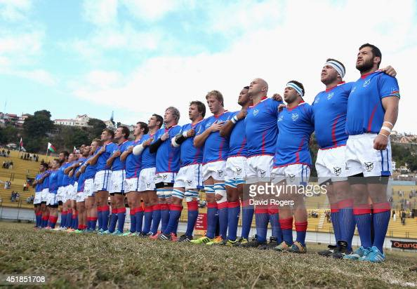 Namibia line up for the anthems during the Rugby World Cup 2015 qualifying match between Madagascar and Namibia at the Mahamasina Stadium on July 6...