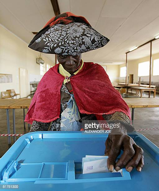 Namibian Herero woman casts her vote in a school classroom in the Ovitoto Province of the Okhandja region some 130 kilometers east of Windhoek 16...