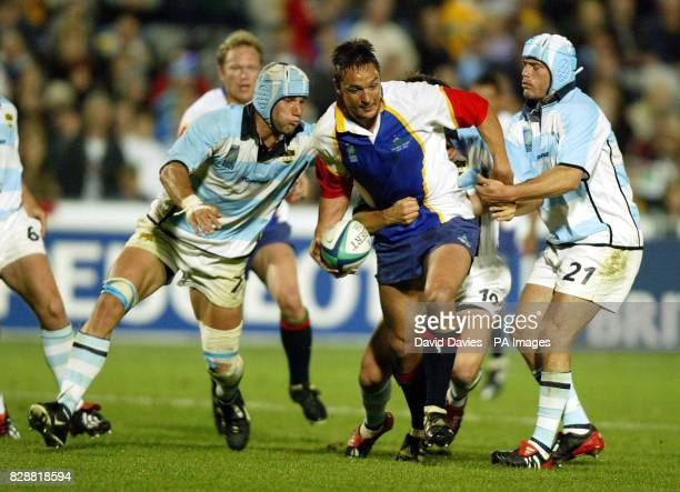 Namibia's Corne Powell tries to break through the tackles of Argentina's Lucas Ostiglia Gonzalo Quesada and Felipe Contepomi during the Rugby World...