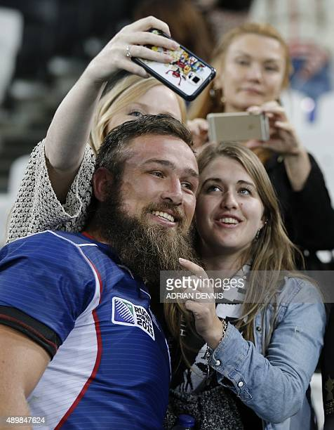 Namibia's lock Pieter Jan van Lill poses for selfie photographs after during a Pool D match of the 2015 Rugby World Cup between New Zealand and...