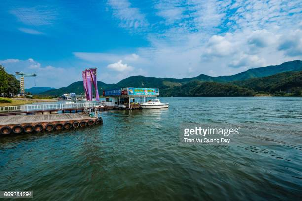 Namisum is a tiny half-moon shaped island located in Chuncheon, South Korea, formed as it was inundated by the rising water of the North Han River as the result of the construction of Cheongpyeong Dam in 1944