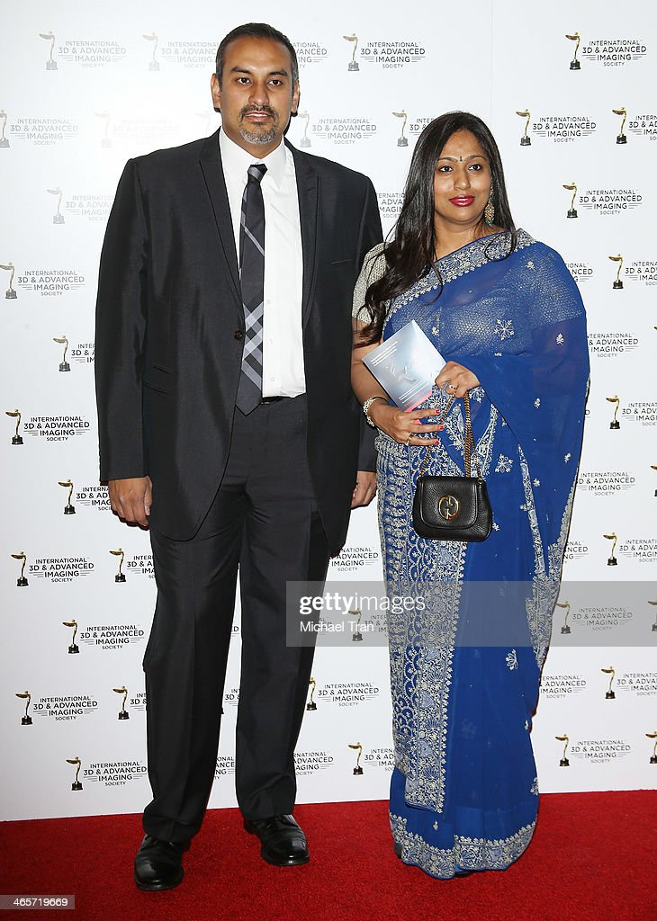 Namit Malhotra (L) and guest arrive at the 2014 International 3D and Advanced Imaging Society's Creative Arts Awards held at Steven J. Ross Theatre on January 28, 2014 in Burbank, California.