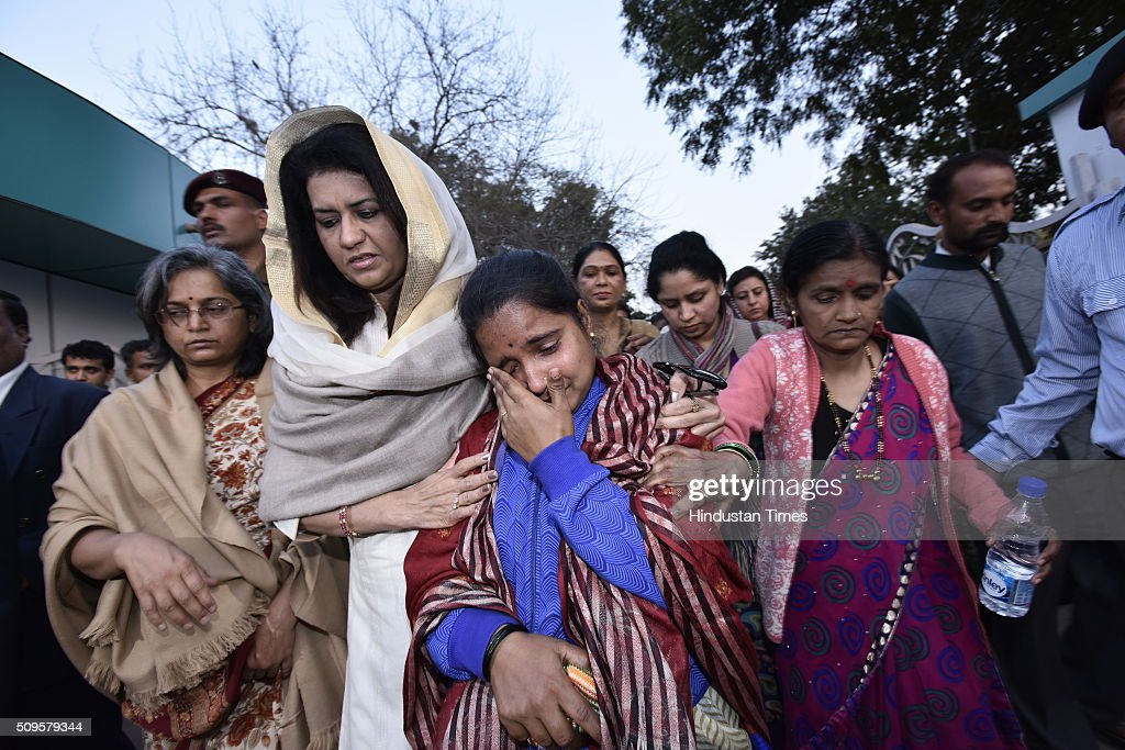 Namita Suhag wife of General Dalbir Singh consoles the family members of the rescued soldier Lance Naik Hanumanthappa during his funeral ceremony at Brar square crematorium on February 11, 2016 in New Delhi, India. Lance Naik Hanamanthappa Koppad of 19 Madras Regiment was rescued alive on night after being buried under 35 feet of snow for six days. The lone survivor of the February 3 Siachen avalanche that claimed the lives of nine soldiers, breathed his last at the Army RR Hospital in Delhi.