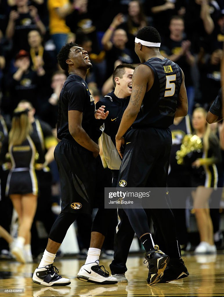 Namon Wright and D'Angelo Allen of the Missouri Tigers celebrate with teammates after Wright hit a threepointer during the game against the Florida...