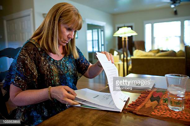 Nan Holmes a senior escrow officer who reviews real estate documents for a title insurer looks through mortgage paperwork during an interview at her...