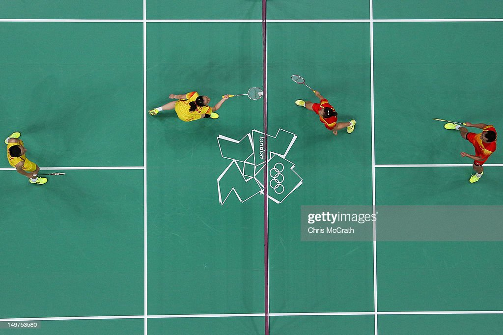 Nan Zhang (L) and Yunlei Zhao (2L) of China compete against compatriots Chen Xu (R) and Jin Ma (2R) in the Mixed Doubles Badminton Gold Medal match on Day 7 of the London 2012 Olympic Games at Wembley Arena on August 3, 2012 in London, England.