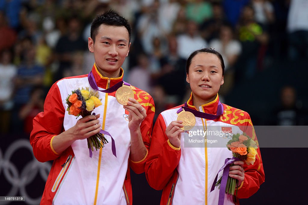 Nan Zhang (L) and Yunlei Zhao of China hold their gold medals in the medal ceremony after winning the Mixed Doubles Badminton Gold Medal match against compatriots Chen Xu and Jin Ma of China on Day 7 of the London 2012 Olympic Games at Wembley Arena on August 3, 2012 in London, England.