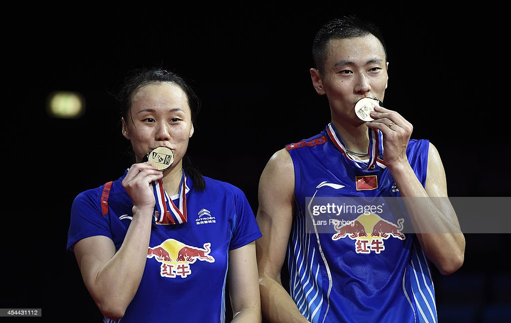 Nan Zhang and Yunlei Zhao of China on the podium receiving their gold medal as world champions in the mixed double against Chen Xu and Jin Ma of China in the finals during the Li-Ning BWF World Badminton Championships at Ballerup Super Arena on August 31, 2014 in Copenhagen, Denmark.