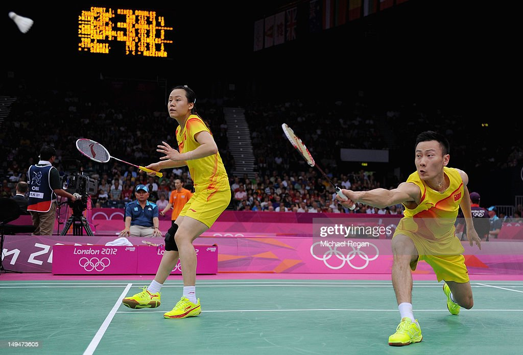 Nan Zhang (R) and Yunlei Zhao (L) of China return a shot against Alexandr Nikolaenko and Valeria Sorokina of Russia during their Mixed Doubles Badminton on Day 2 of the London 2012 Olympic Games at Wembley Arena on July 29, 2012 in London, England.