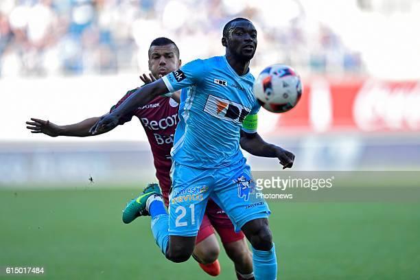 Nana Asare defender of KAA Gent holds off the challenge of Alessandro Cordaro midfielder of SV Zulte Waregem during the Jupiler Pro League match...