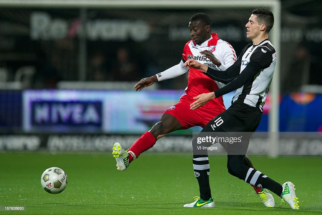 Nana Asare of FC Utrecht, Marko Vejinovic of Heracles Almelo during the Dutch Eredivisie match between Heracles Almelo and FC Utrecht at the Polman Stadium on December 7, 2012 in Almelo, The Netherlands.