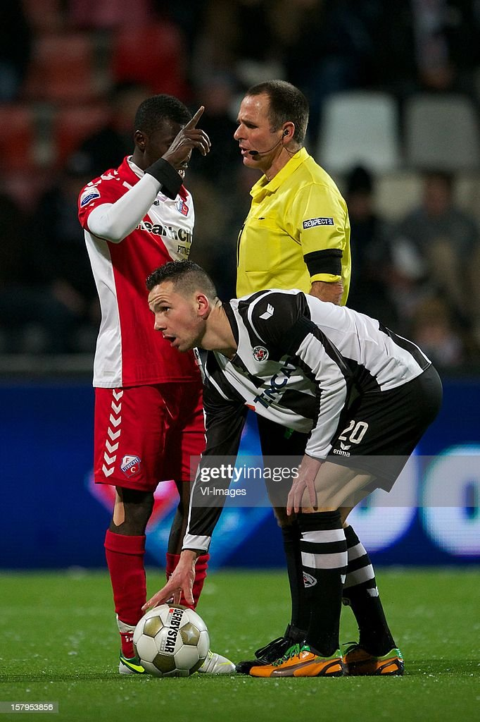Nana Asare of FC Utrecht, referee Ruud Bossen, Thomas Bruns of Heracles Almelo during the Dutch Eredivisie match between Heracles Almelo and FC Utrecht at the Polman Stadium on December 7, 2012 in Almelo, The Netherlands.
