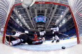 Nana Fujimoto of Japan gives up a goal by Galina Skiba of Russia in the third period during the Women's Ice Hockey Classification game on day nine of...
