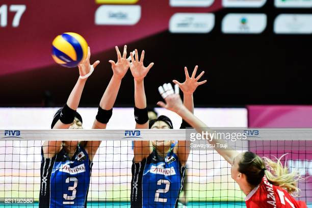Nana Iwasaka and Sarina Koga of Japan block the ball during the FIVB Volleyball World Grand Prix match between Japan and Russia on July 23 2017 in...