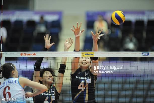 Nana Iwasaka and Yuki Ishii of Hisamitsu Spring in action against Yana Shcherban of Dinamo Moscow during the pool match of the FIVB Womens Club World...