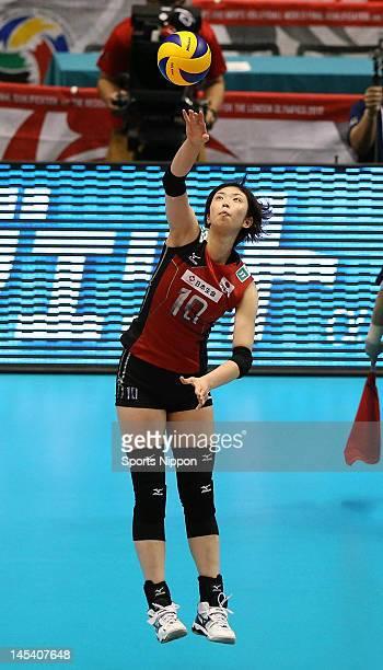 Nana Iwasaka of Japan serves the ball during the FIVB Women's World Olympic Qualification tournament match between Japan and Thailand at Yoyogi...