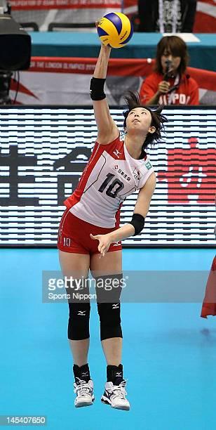 Nana Iwasaka of Japan serves the ball during the FIVB Women's World Olympic Qualification tournament match between Japan and Cuba at Yoyogi Gymnasium...