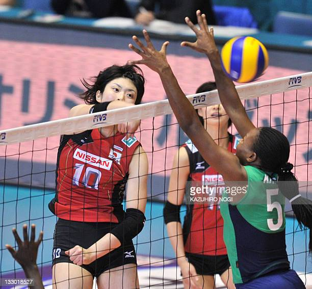 Nana Iwasaka of Japan spikes the ball past Diana Khisa of Kenya during their World Cup women's volleyball tournament in Tokyo on November 16 2011 AFP...