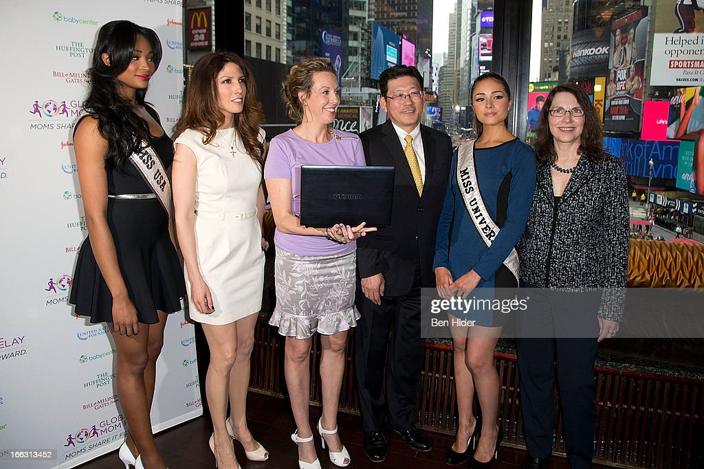 <a gi-track='captionPersonalityLinkClicked' href=/galleries/search?phrase=Nana+Meriwether&family=editorial&specificpeople=4594046 ng-click='$event.stopPropagation()'>Nana Meriwether</a>, Miss USA 2012, Lynda Lopez, Sharon D'Agostino, Yoshi Uchiyama, <a gi-track='captionPersonalityLinkClicked' href=/galleries/search?phrase=Olivia+Culpo&family=editorial&specificpeople=9194131 ng-click='$event.stopPropagation()'>Olivia Culpo</a>, Miss Universe 2012 and Elizabeth Gore attends Global Mom Relay Video Launch Event at Times Square on April 11, 2013 in New York City.