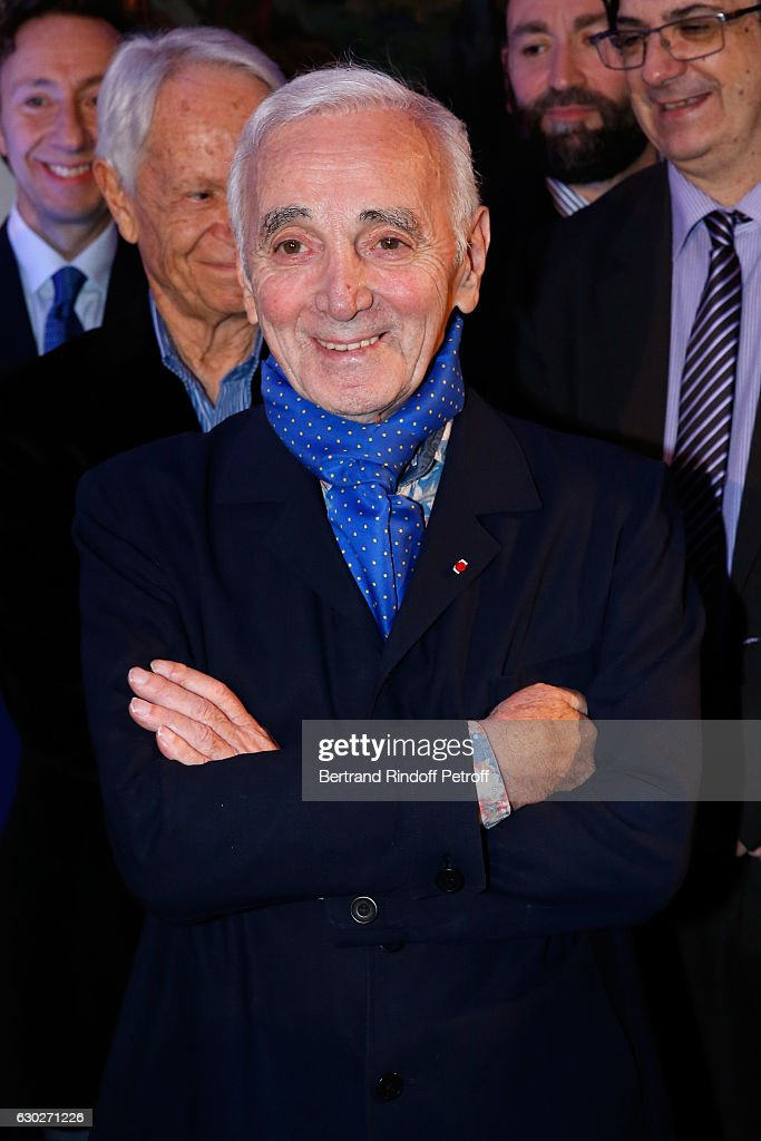 Nana Mouskouri gives the Greek Prize 'Nikos Gatsos 2016' to Charles Aznavour (on picture) at Embassy of Greece on December 19, 2016 in Paris, France.