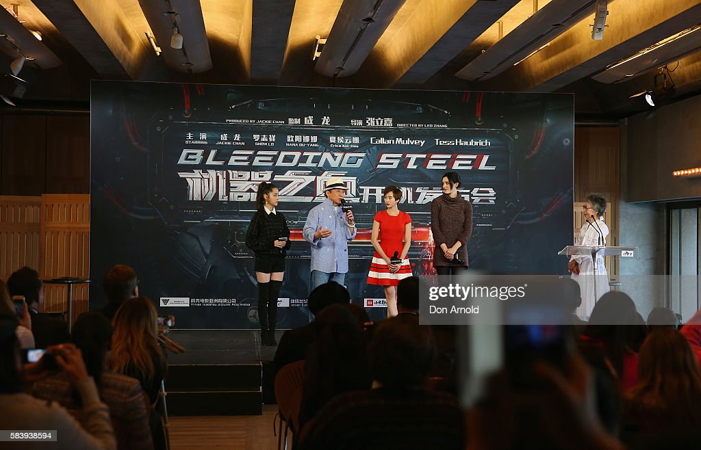 Nana Ouyang, Jackie Chan, Erica Xia-hou and Tess Haubrich look on as Lee Lin Chin addresses media during a press conference and photocall for Bleeding Steel at Sydney Opera House on July 28, 2016 in Sydney, Australia.